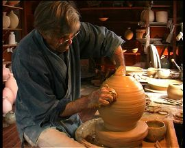 Peter at wheel making vase